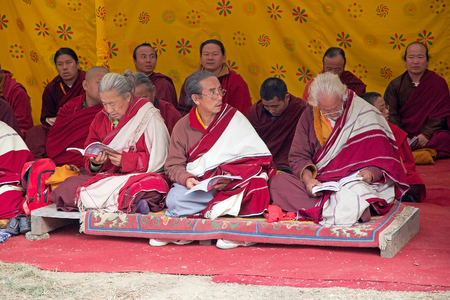 conceived: Buddhist monks in traditional robes are praying at the Memorial Chorten, Thimphu, Bhutan. The Memorial Chorten was conceived by Thinley Norbu, according to the Nyingma tradition of Tibetan Bhuddism. It was erected in 1974 in memory of Jigme Dorji Wanchuck
