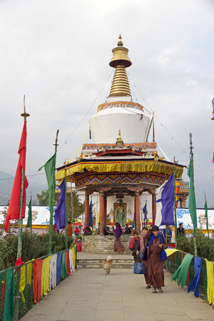 conceived: Bhutanese people at the Memorial Chorten, Thimphu, Bhutan. The Memorial Chorten was conceived by Thinley Norbu, according to the Nyingma tradition of Tibetan Bhuddism. It was erected in 1974 in memory of Jigme Dorji Wanchuck, 3rd Druk Gyalpo, who had died Editorial