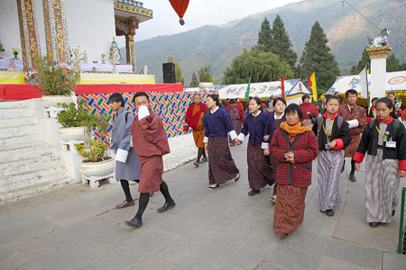 conceived: Bhutanese people are praying walking clokwise around the Memorial Chorten, Thimphu, Bhutan. The Memorial Chorten was conceived by Thinley Norbu, according to the Nyingma tradition of Tibetan Bhuddism. It was erected in 1974 in memory of Jigme Dorji Wanchu