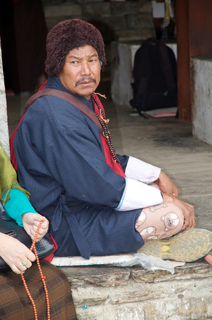 conceived: Bhutanese man at the Memorial Chorten, Thimphu, Bhutan. The Memorial Chorten was conceived by Thinley Norbu, according to the Nyingma tradition of Tibetan Bhuddism. It was erected in 1974 in memory of Jigme Dorji Wanchuck, 3rd Druk Gyalpo, who had died in