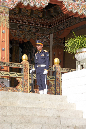 govern: Soldier at the entrance of the Trashi Chhoe Dzong, Thimphu, Bhutan. Trashi Chhoe Dzong is a Buddhist monastery and fortress on the northern edge of the city of Thimphu. It has traditionally been the seat of the Druk desi, the head of Bhutans civil govern