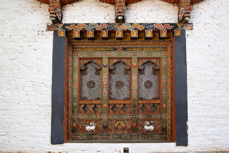 traditonal: Finely carved wooden window at the Punakha Dzong, Punakha, Bhutan. Punakha Dzong is the administrative centre of Punakha District. It was was built in 1637-38 by Ngawang Namgyal, 1st Zabdrung Rimpoche. The Dzong is located at the confluence of the Pho Chh