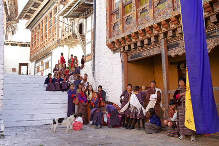 sh: Bhutanese people with tarditional clothes at the Trongsa Dzong, Trongsa, Bhutan. Trongsa Dzong is the largest dzong fortress in Bhutan. A temple was first established at the location in 1543 by the Drukpa Lama Ngagi Wangchuk. In 1647 his great-grandson Sh Editorial