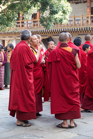 robes: Buddhist monks in traditional robes are paying tribute during the birth anniversary ceremony of the 4th King at the Punakha Dzong, Punakha, Bhutan. The Dzong was built in 1637-38 by Ngawang Namgyal, 1st Zabdrung Rimpoche. The Dzong is the second oldest an