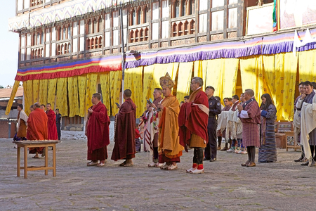 robes: Buddhist monks in traditional robes are attending at the celebration for the birthday of the 4th King of Bhutan at the Trongsa Dzong, Trongsa, Bhutan. Trongsa Dzong is the largest dzong fortress in Bhutan. A temple was first established at the location in