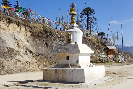 metre: Chorten and prayer flags at Yutong La Pass, Bhutan. Prayer flags come in sets of five: one in each colors. The five colors are arranged from left to right in a specific order: blue, white, red, green and yellow. Yutong La Pass is an altitude of 3425 metre