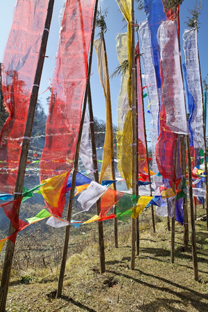 praye: Praye flags at Yutong La Pass, Bhutan. Prayer flags come in sets of five: one in each colors. The five colors are arranged from left to right in a specific order: blue, white, red, green and yellow. Yutong La Pass is an altitude of 3425 metres