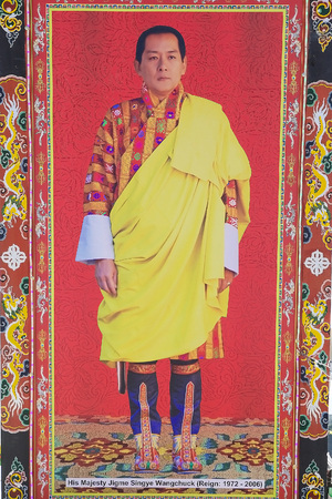 favour: The 4th King of Bhutan, Jigme Singye Wangchuck, image at the Yutong La Pass, Bhutan. The 4th King of Bhutan was born in 1955 and was King from 1972 since his abdication in favour of his oldest son, in 2006. The pass is a 3425 metres high. Editorial