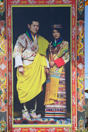 reigning: The 5th King of Bhutan, Jigme khesar Namgyel Wangchuck, and his wife Jetsun Pema, at the Yutong La Pass, Bhutan. The 5th King of Bhutan was born in 1980, become King in 2006 and He is the current reigning of the Kingdom of Bhutan. The pass is a 3425 metre