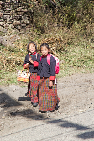 introduced: Bhutanese students with traditonal clothes in the Chhume village, Bhutan. Western style education was introduced in Bhutan during the reign of Ugyen Wangchuck (1907-1926).