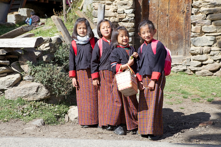 traditonal: Bhutanese students with traditonal clothes in the Chhume village, Bhutan. Western style education was introduced in Bhutan during the reign of Ugyen Wangchuck (1907-1926).