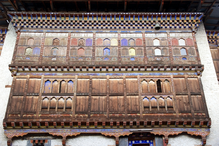 monarchy: Details of the facade of the tower at the Wangduechhoeling Palace ruins, Bumthang, Bhutan. The palace was built in 1856 by Trongsa Penlop Jigme Namgyel and it is the birthplace of the Bhutans monarchy. Stock Photo