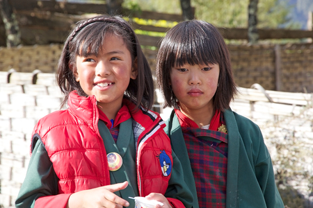 median: Bhutanese children  at the Gangteng village, Phobjikha Valley, Bhutan. Bhutan has a population of less than 1 million people and the Bhutanese people has a median age of 24.8 years