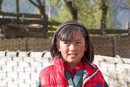 median age: Bhutanese child at the Gangteng village, Phobjikha Valley, Bhutan. Bhutan has a population of less than 1 million people and the Bhutanese people has a median age of 24.8 years Editorial
