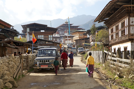 gompa: Bhutanese people are walking along the street at the Gangteng village, Bhutan to Gangtey Monastery Editorial