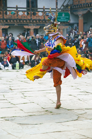 gompa: Dancer with traditional clothes are performing the Mask dance during the Black-necked crane Festival at the Gangtey Monastery also known as Gantey Gompa, Gangten, Bhutan. Gangtey Monastery is an important monastery of Nyingmapa school of Buddhism. The mon