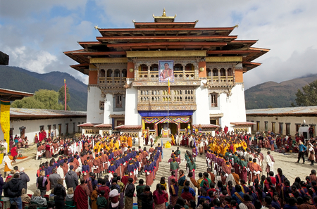 gompa: Bhutanese people at the Gangtey Monastery also known as Gantey Gompa, Gangten, Bhutan, during the Black-necked crane Festival and during the National anthem and flag-rising. Gangtey Monastery is an important monastery of Nyingmapa school of Buddhism. The