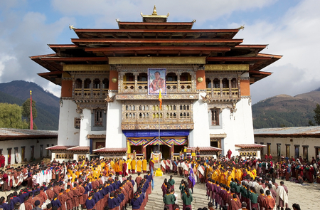 Bhutanese people at the Gangtey Monastery also known as Gantey Gompa, Gangten, Bhutan, during the Black-necked crane Festival and during the National anthem and flag-rising. Gangtey Monastery is an important monastery of Nyingmapa school of Buddhism. The
