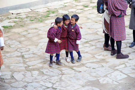 gompa: Bhutanese children in traditional clothes are attending at the ceremony during the Black-necked crane Festival at the Gangtey Monastery also known as Gantey Gompa, Gangten, Bhutan. Gangtey Monastery is an important monastery of Nyingmapa school of Buddhis