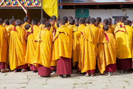 robes: Buddhist monks with traditional robes are attending at the ceremony during the Black-necked crane Festival at the Gangtey Monastery also known as Gantey Gompa, Gangten, Bhutan. Gangtey Monastery is an important monastery of Nyingmapa school of Buddhism. T Editorial
