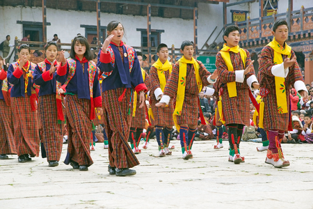 gompa: Dancers with traditional clothes are performing the Welcome dance during the Black-necked crane Festival at the Gangtey Monastery also known as Gantey Gompa, Gangten, Bhutan. Gangtey Monastery is an important monastery of Nyingmapa school of Buddhism. The Editorial