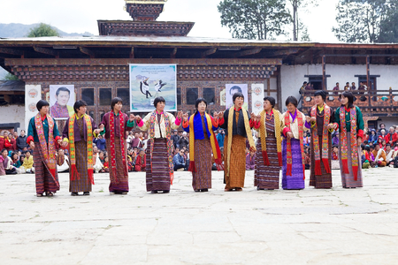 gompa: Dancers, women from the local community, with traditional clothes are performing the Zhungdra dance during the Black-necked crane Festival at the Gangtey Monastery also known as Gantey Gompa, Gangten, Bhutan. Gangtey Monastery is an important monastery of Editorial