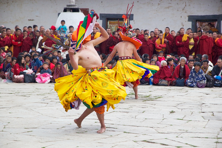 gompa: Dancers with traditional clothes are performing the Mask dance during the Black-necked crane Festival at the Gangtey Monastery also known as Gantey Gompa, Gangten, Bhutan. Gangtey Monastery is an important monastery of Nyingmapa school of Buddhism. The mo