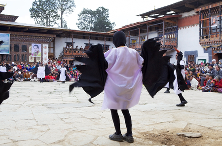 gompa: Dancers, children from the local community, with traditional clothes are performing the Black-necked Crane dance during the Black-necked crane Festival at the Gangtey Monastery also known as Gantey Gompa, Gangten, Bhutan. Gangtey Monastery is an important Editorial