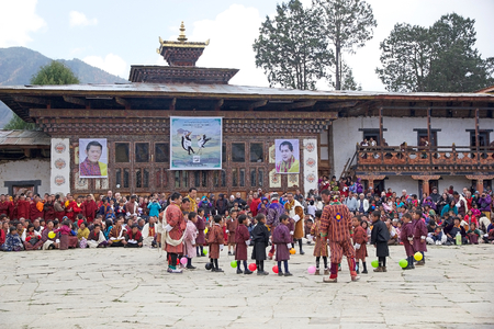 gompa: Children from the local community with traditional clothes are ready to start the Balloon blasting competition during the Black-necked crane Festival at the Gangtey Monastery also known as Gantey Gompa, Gangten, Bhutan. Gangtey Monastery is an important m