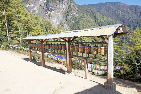The prayer wheels along the footpath to the Tigers Nest, Paro, Bhutan. Taktsang Palphug Monastery also known as Tigers Nest is a prominent Himalayan Buddhist sacred site and temple complex built in 1692. According to the legend, it is believed that Guru