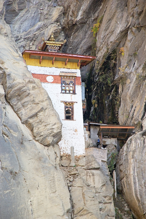 Hermitage at the Tigers Nest complex, Paro, Bhutan. Taktsang Palphug Monastery also known as Tigers Nest is a prominent Himalayan Buddhist sacred site and temple complex. A temple complex was first built in 1692. According to the legend, it is believed  Stock Photo