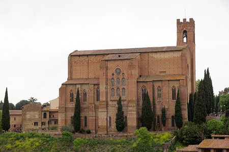begun: Basilica of San Domenico, Siena, Tuscany, Italy. It is one of the most important in the city. It was begun in 1226-1265 and was enlarged in 14th century. It was built in brick with a lofty bell tower