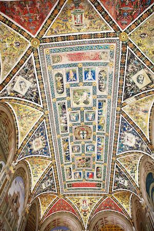 italian fresco: Piccolomini library ceiling, Siena, Tuscany, Italy. Adjoining the Siena Cathedral is the Piccolomini library, housing precoius illuminated choir books and frescoes painted by Pinturicchio, probalby based on designs by Raphael Editorial