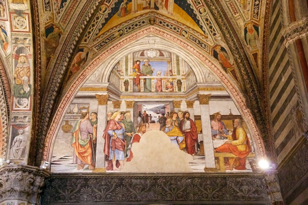 Fresco at the Baptistery of San Giovanni, Siena, Tuscany, Italy. The Baptistery of San Giovanni was built below the Cathedral of Siena by master-builder Camaino di Crescentino between the second and third decades of XIV century. The rectangular plan churc Editorial