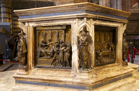 baptismal: Details of the baptismal font at the Baptistery of San Giovanni, Siena, Tuscany, Italy. The Baptistery of San Giovanni was built below the Cathedral of Siena by master-builder Camaino di Crescentino between the second and third decades of XIV century. The