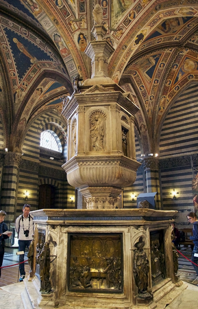 baptismal: The baptismal font at the Baptistery of San Giovanni, Siena, Tuscany, Italy. The Baptistery of San Giovanni was built below the Cathedral of Siena by master-builder Camaino di Crescentino between the second and third decades of XIV century. The rectangula