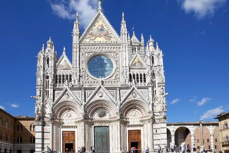 Siena Cathedral facade in historic city of Siena, Tuscany, Italy. Siena Cathedral, Metropolitan Cathedral of Saint Mary of the Assumption, was built in 1215-1263 on the site of an earlier structure.