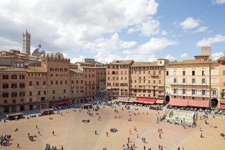 Piazza del Campo view. Piazza del Campo is the principal public space of the historic centre of Siena, Tuscany, Italy. The mansions that line the shell-shaped square have unified the rooflines. The twice a year horse race, Palio di Siena, is held around t