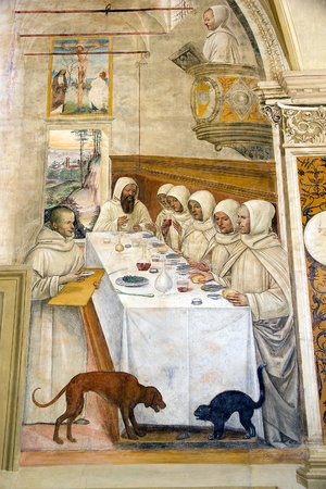 How St Benedict get flour in aboundance and restores the monks fresco, date 1439. The frescoes of life of St Benedict was painted by Luca Signorelli an Sodoma in the Great Cloister in the Abbey of Monte Oliveto Maggiore, a Benedictin monastery 10 Km south
