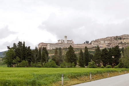 of assisi: Panorama of Assisi, Italy. Assisi is a town in Province of Perugia in Umbria Region, on the western flank of Monte Subasio. It was the birthplace of St. Francis, who founded the Franciscan religious order in the town in 1208 and St. Clare, the founder of  Stock Photo