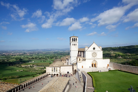 of assisi: Pilgrims and tourists are visiting the Basilica of San Francesco dAssisi in Assisi, Umbria, Italy. Assisi is a town in Province of Perugia in Umbria Region, on the western flank of Monte Subasio. It was the birthplace of St. Francis, who founded the Fran