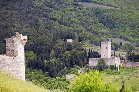 joins: Fortress Minor, Assisi, Italy. The Rocca Maggiore joins, trought the 14th century walls, with its fortress Minor.  Rocca Maggiore dominated by more than eight hundred years the citadel of Assisi and the valley of Tescio. The first documented regarding the