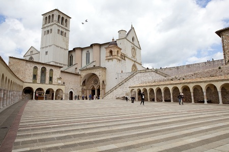 of assisi: Pilgrims and tourists are visiting the Basilica of San Francesco dAssisi, upper church, in Assisi, Italy. Assisi is a town in Province of Perugia in Umbria Region, on the western flank of Monte Subasio. It was the birthplace of St. Francis, who founded t