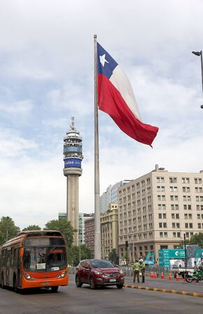 chilean: Chilean police along the street with flags of Chile in the background in Santiago, Chile Editorial