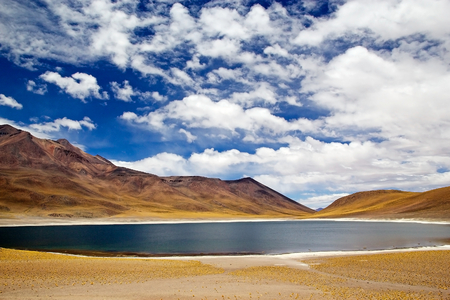 metres: Miniques lagoon landscape in the Atacama desert, Chile. Miniques lagoons is a brackish water lake located 4000 metres above the sea level in the Antofagasta Region in northern Chile, about 100 Km from San Pedro de Atacama. Stock Photo