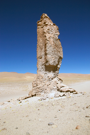 Geological monolith close to Salar the Tara in the Los Flamencos National Reserve, Chile. It is an impressiv volcanic column modified by erosion at 4870 meters above the sea level.