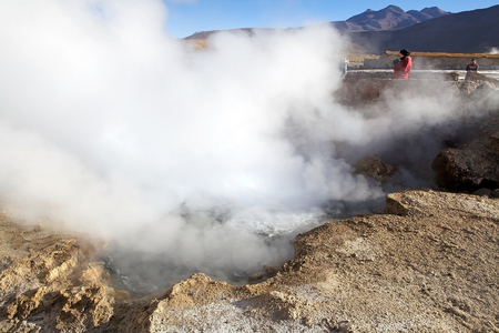Tourists are visiting the El Tatio geysers, Chile. El Tatio is a geyser field located in the northern Chile. It is the largest geyser field in the southern hemisphere and the third geyser field in the world.