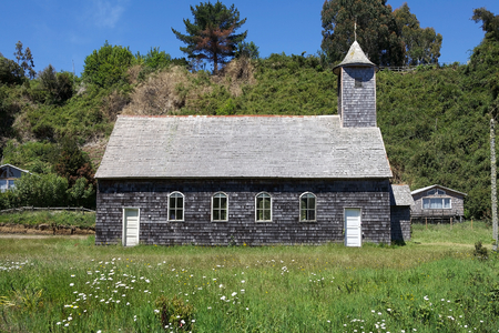 Traditional wodden church at the Caulin village in the Chiloe island, Chile. The churches of Chiloe are one of the prominent styles of Chilota architecture. The churches are made in native timber with use of wood shingles.