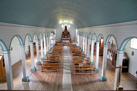 Interior of the Church of Tenaun at Dalcahue, Chiloe Island, Chile. It was declared National Monumento of Chile in 1999 and it is one of the 16 churches thath were declared by UNESCO World Heritage Site in 2000. Editorial