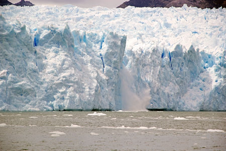 Ice collapse at the San Rafael Glacier view from the lagoon, Patagonia Chile. It is one of the major outlet glacier of the Northern Patagonia Ice Field in southern Chile and it is the glacier nearest the Equator.